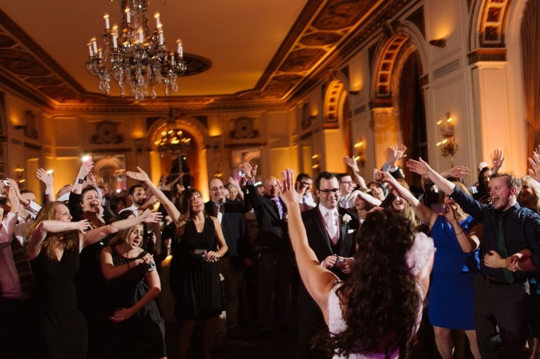Guests wave their arms at wedding reception at the Colony Club in Detroit