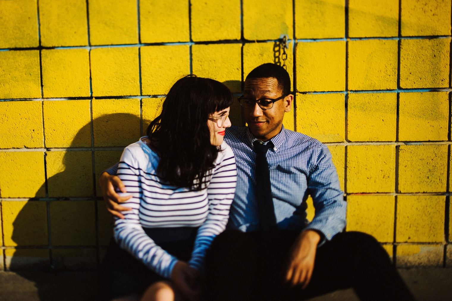 couples portrait with yellow