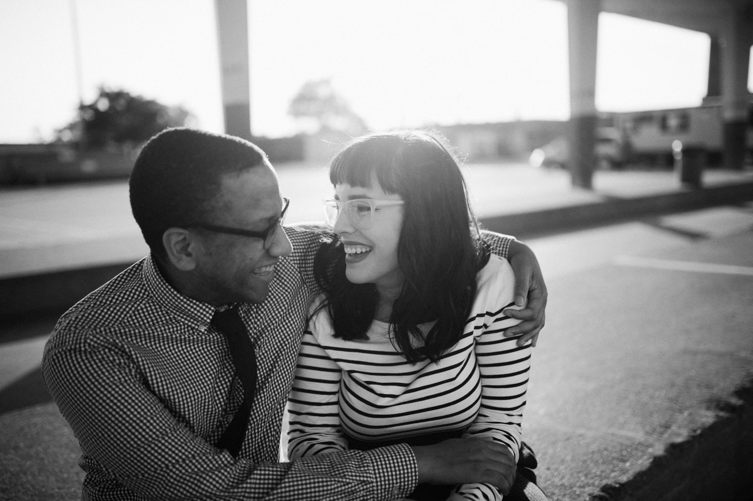 couple laughing during their engagement session in eastern market detroit