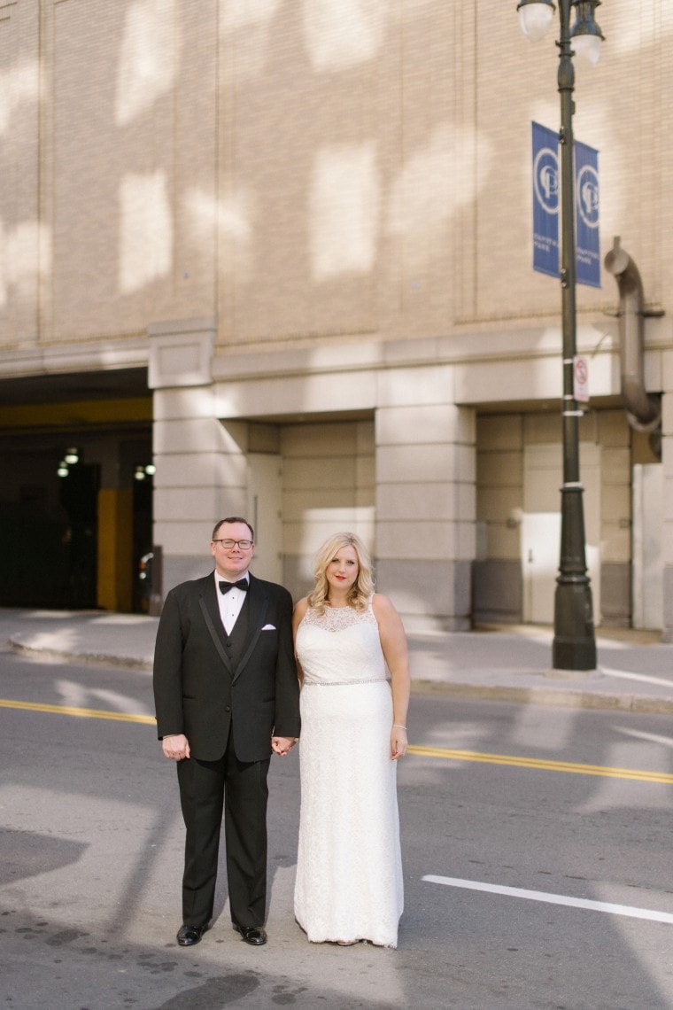 Bride and groom take portraits around downtown Detroit.