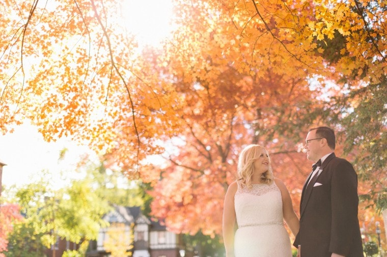 Bride and groom take portraits in Detroit's Indian Village Neighborhood amongst Michigan's fall foliage.