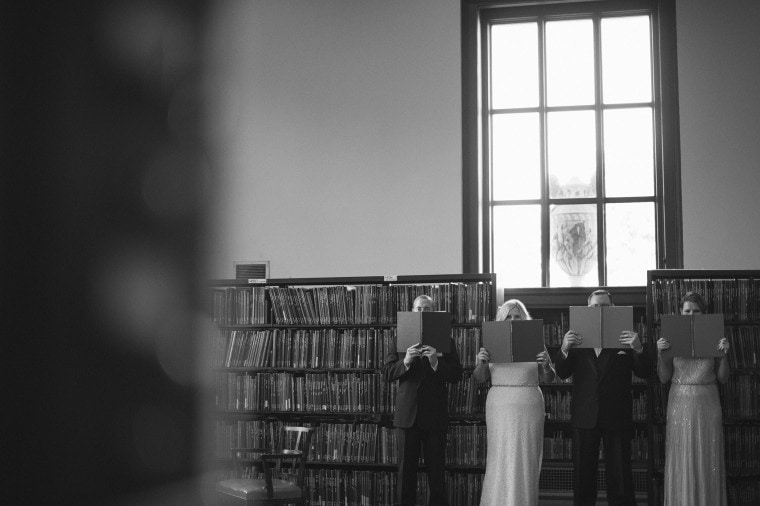 A wedding party poses for portraits inside the Detroit public library.