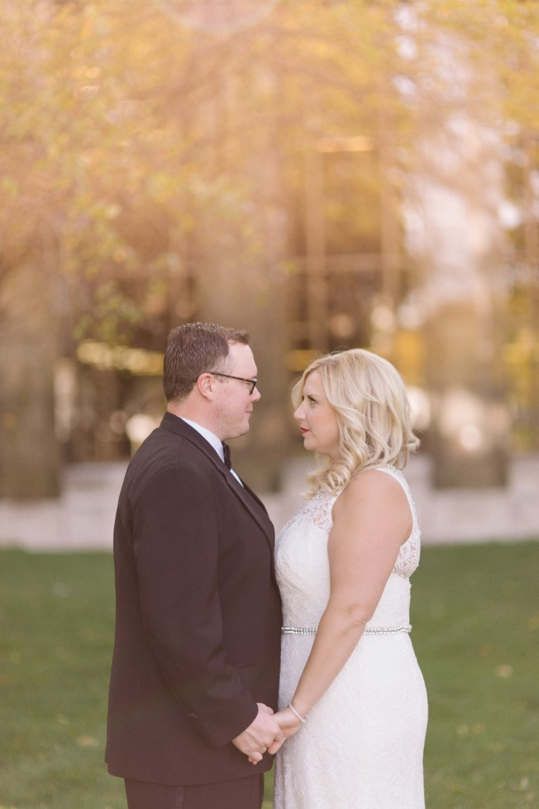 Bride and groom photographed outside the Detroit Public Library by wedding photographer Heather Jowett.