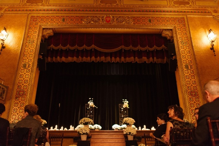 the stage of the Gem Theater in Detroit set up for a wedding.