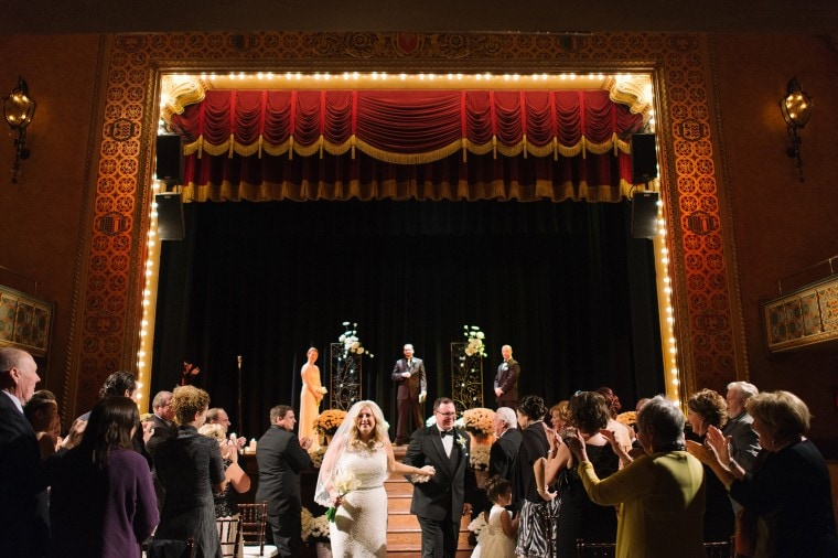 The stage lights flash after a wedding ceremony at the Gem Theater in Detroit
