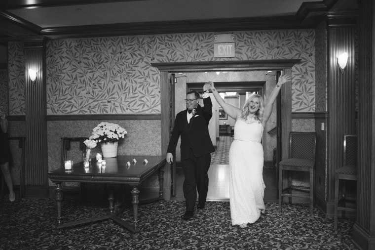 Bride and groom enter their wedding reception at the Gem Theater in Detroit