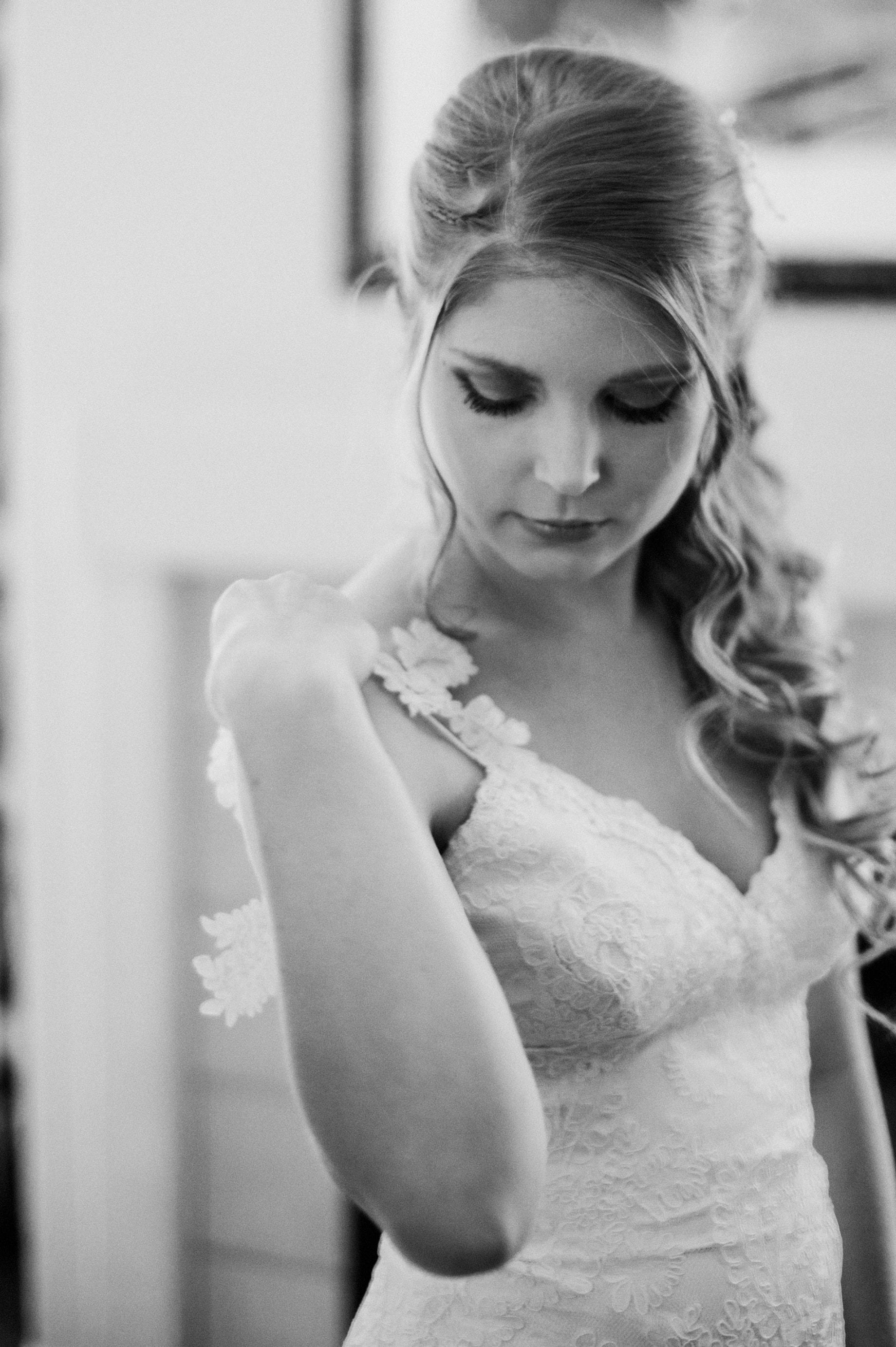 bride wearing a katie may dress