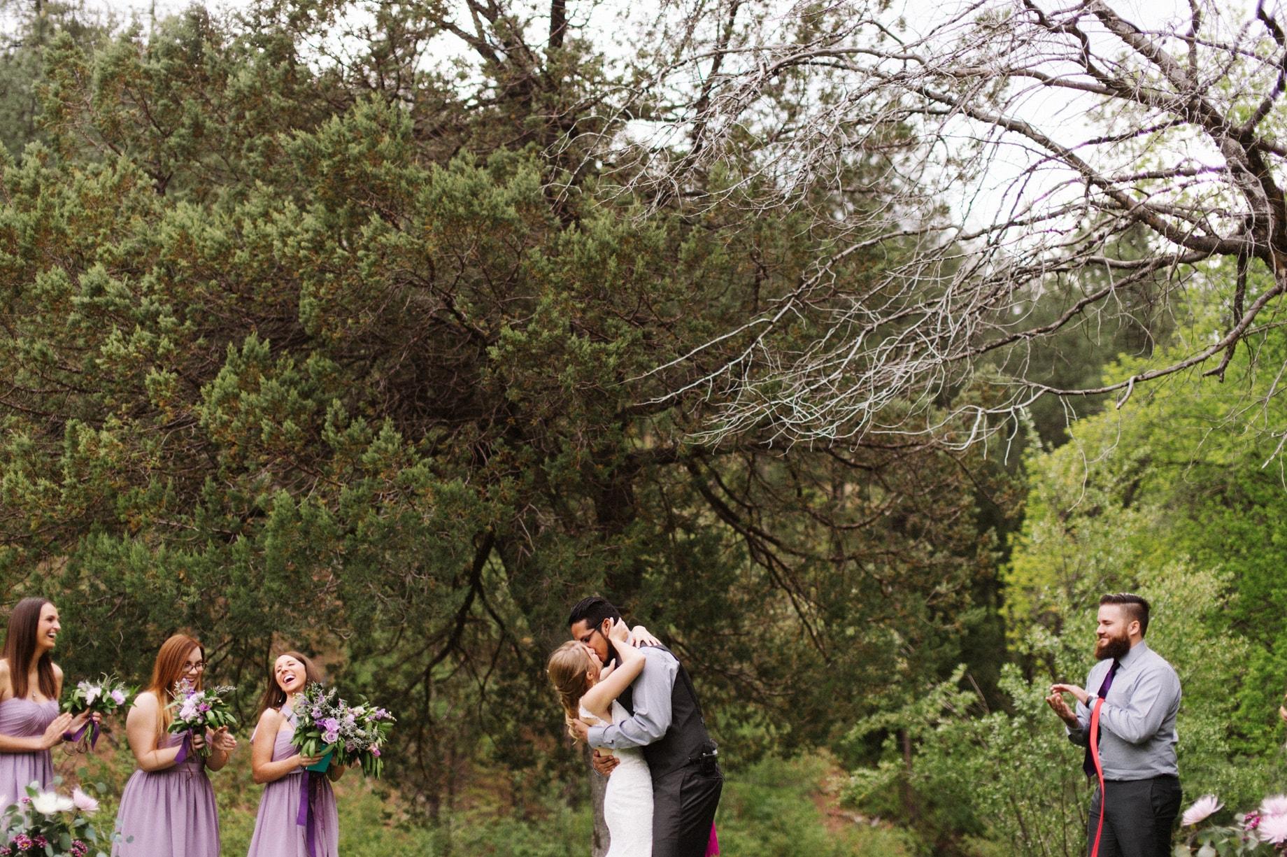 couple kisses at camp wedding