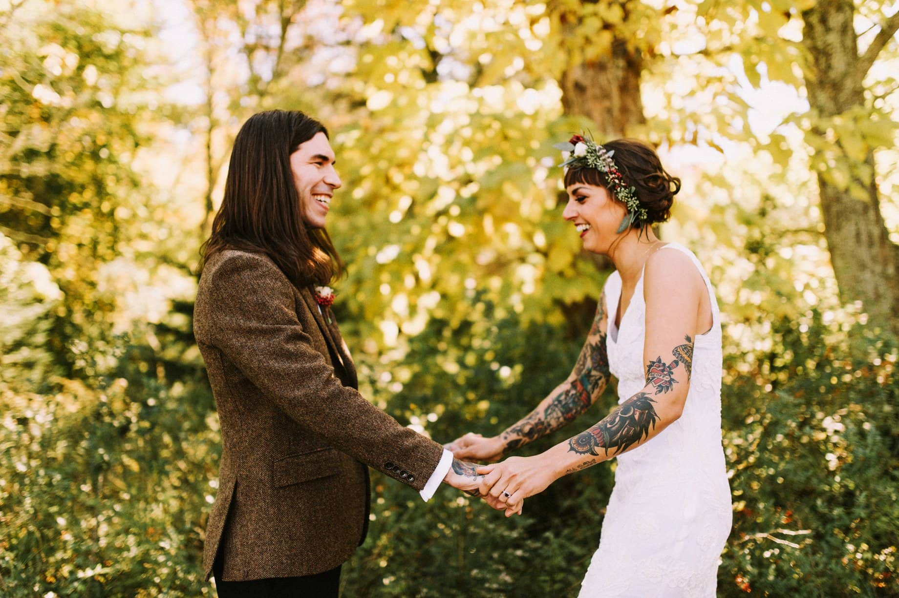 tattooed bride and groom first look
