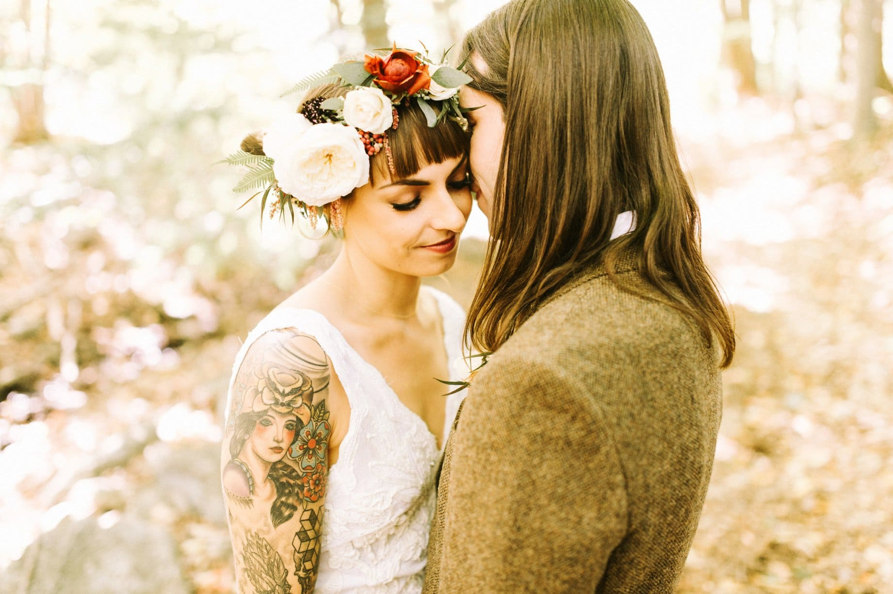 bride with tattoos and flower crown