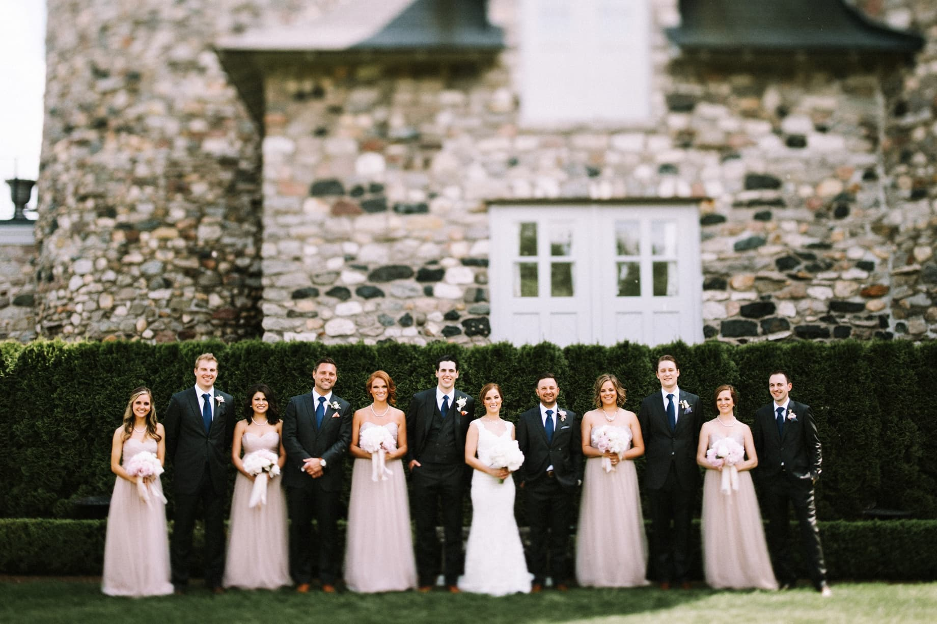 wedding party in peach and gray