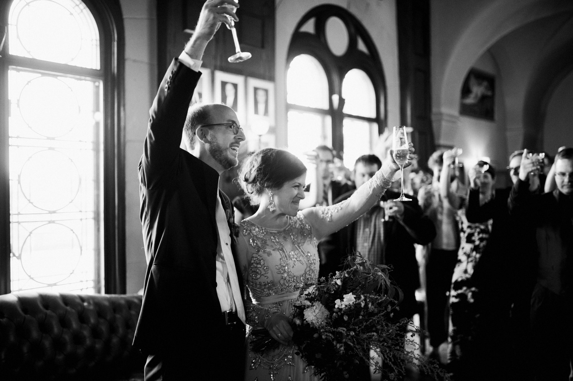 bride and groom toast to their guests