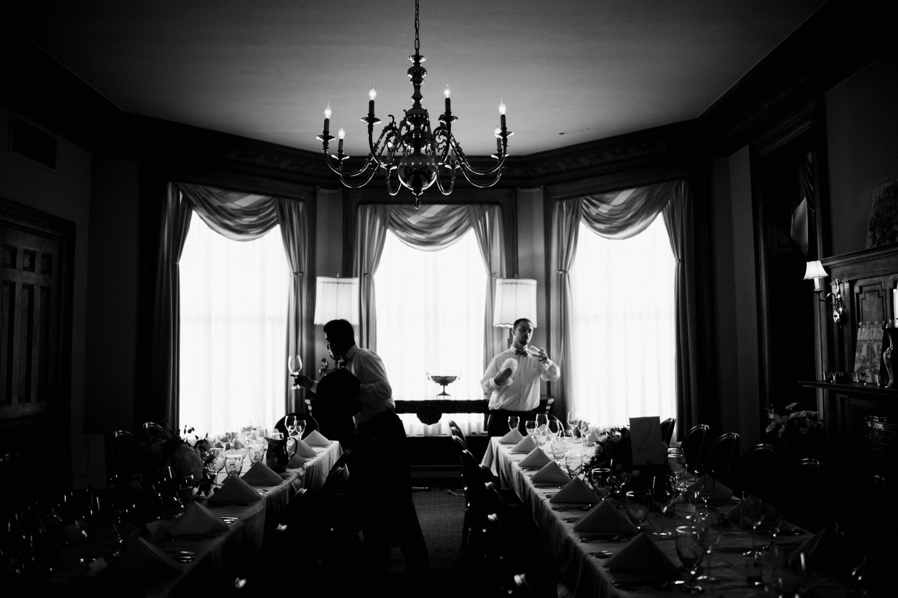 waiters preparing for a wedding reception at the whitney in detroit