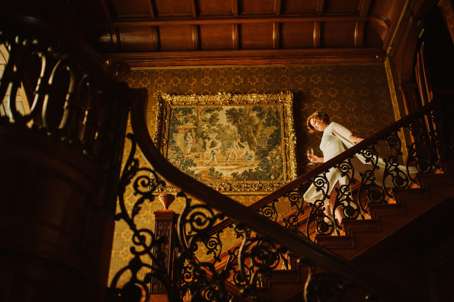 artist bride in flowing white bridal kimono descending the stairs at her detroit wedding
