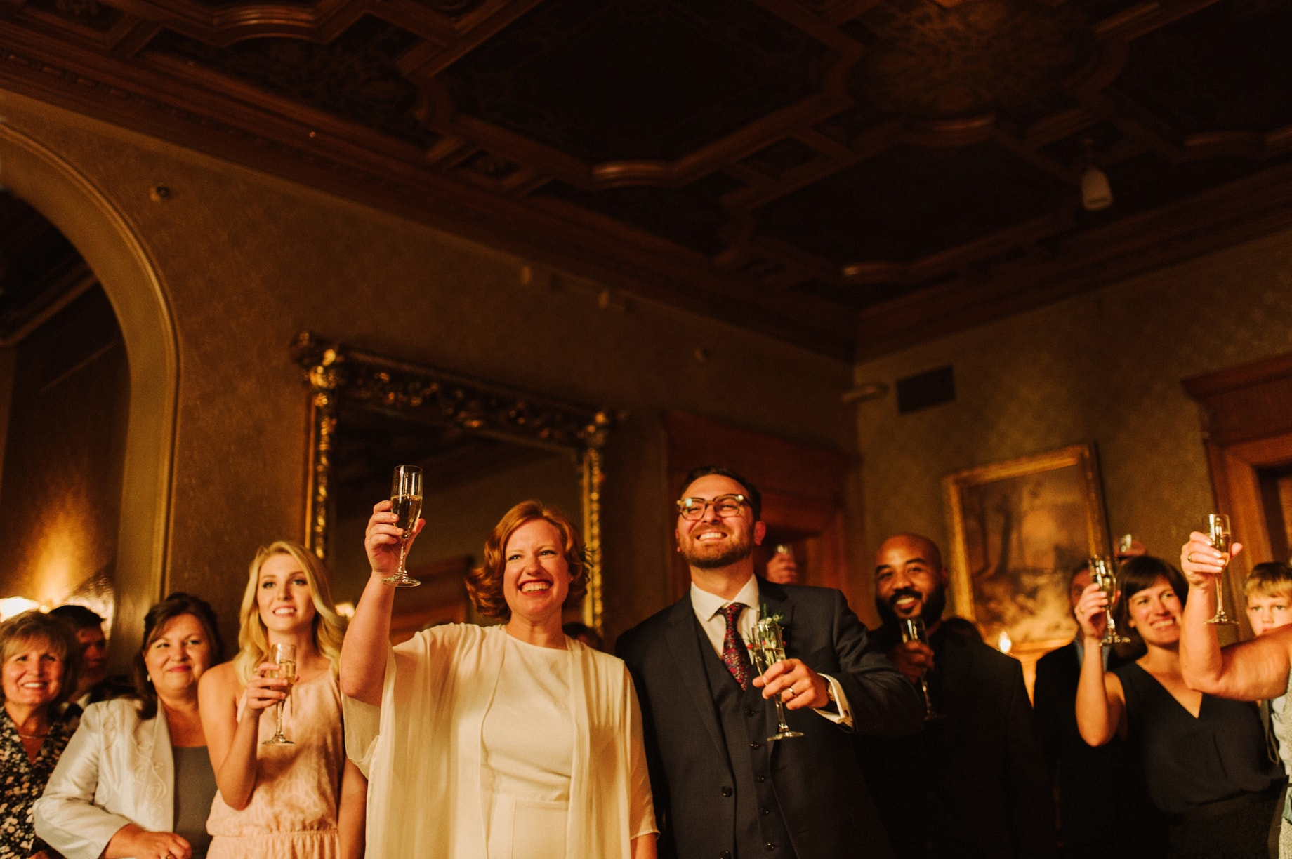 bride and groom raising a glass at their whitney mansion wedding