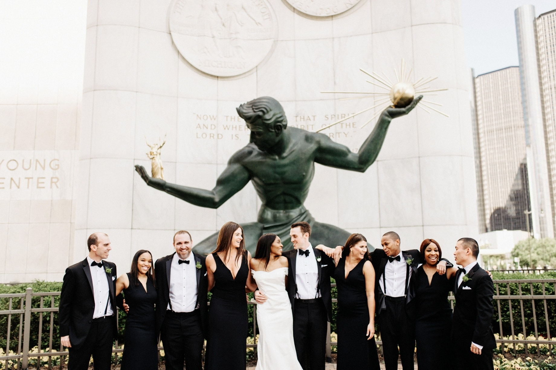 wedding party in front of the spirit of Detroit sculpture
