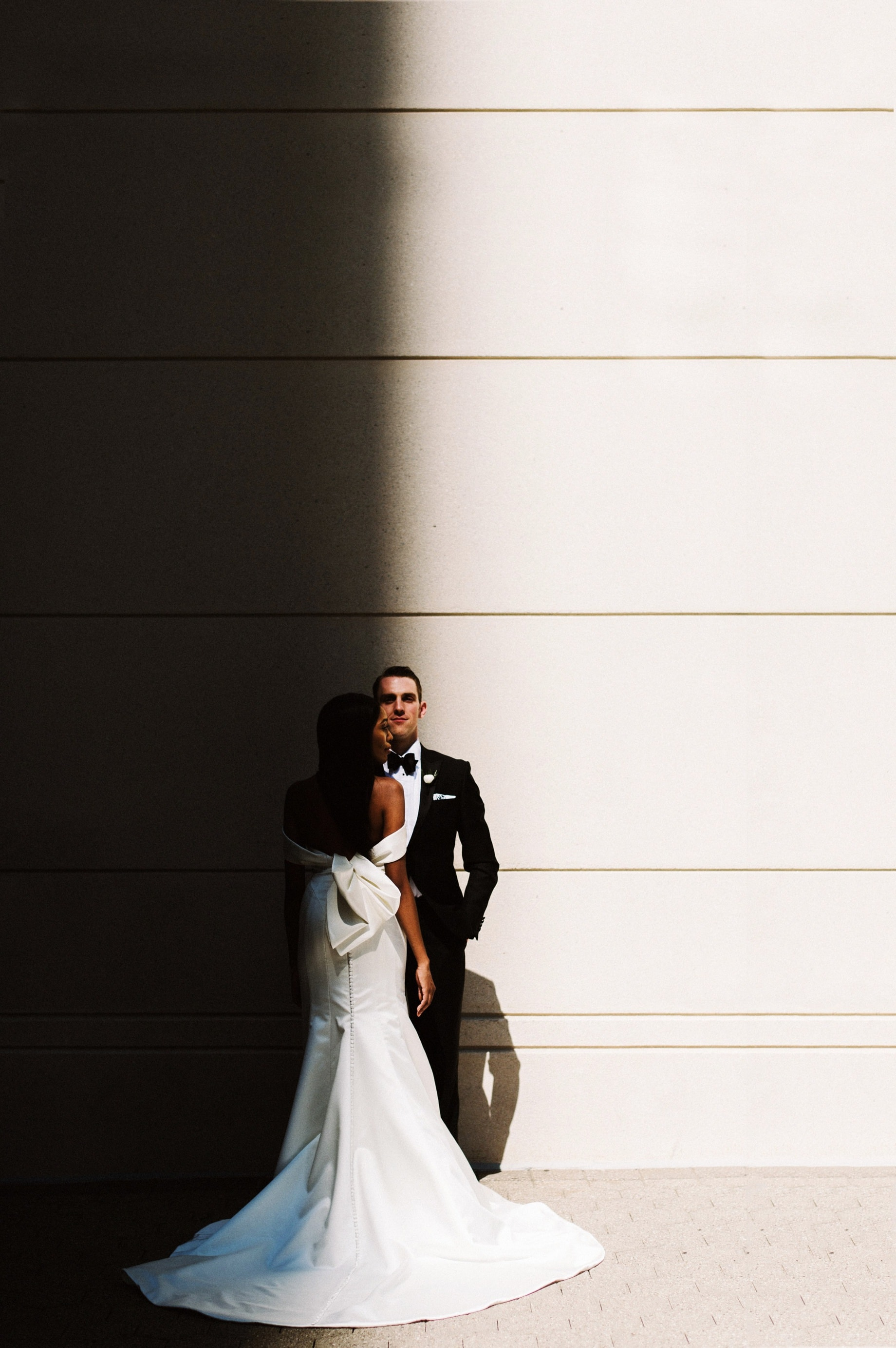 dramatic lighting bride and groom portrait