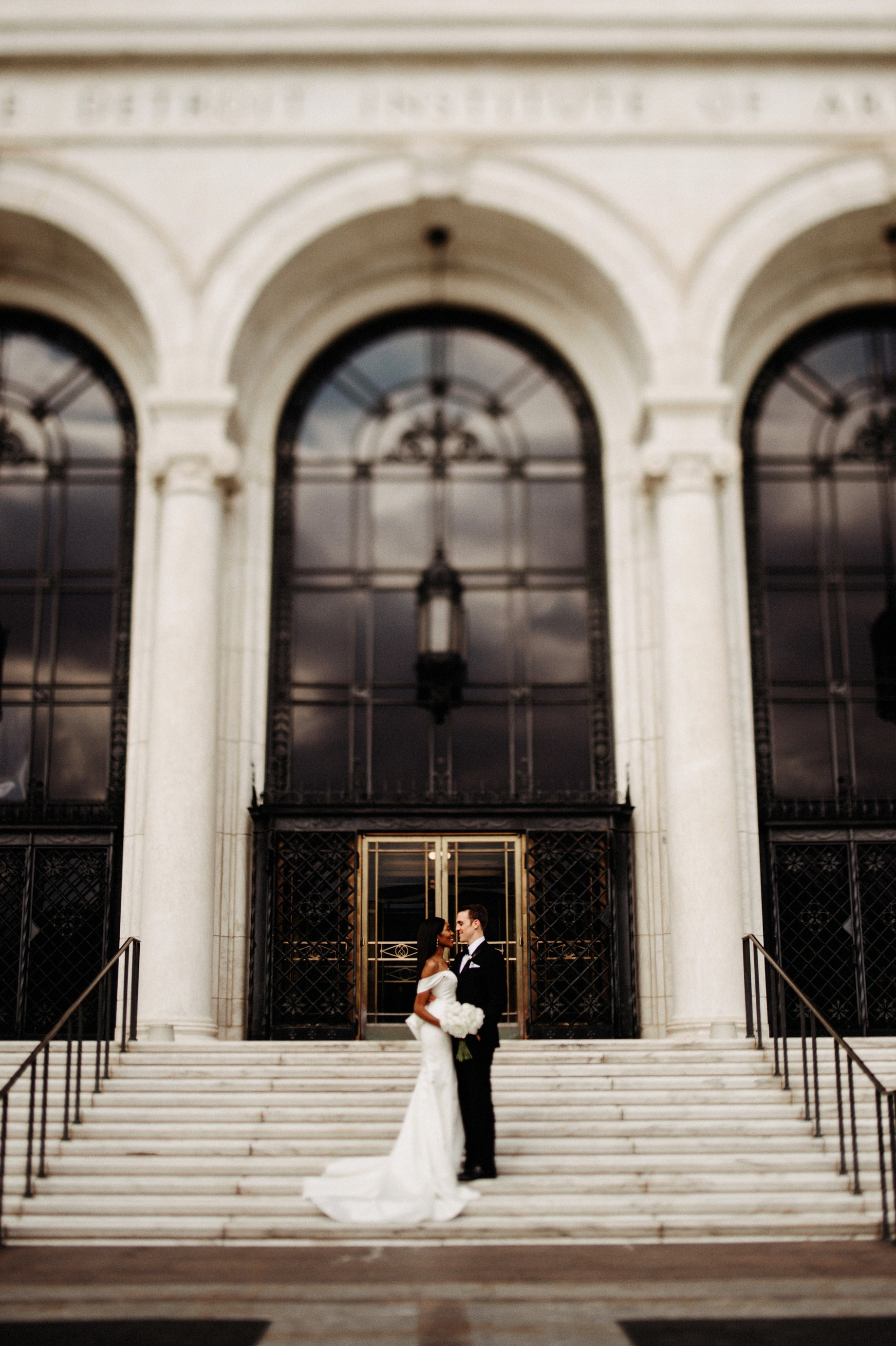 bride and groom outside of their Detroit Institute of Arts wedding