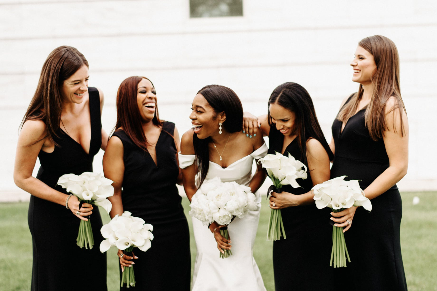 bride with bridesmaids in black gowns