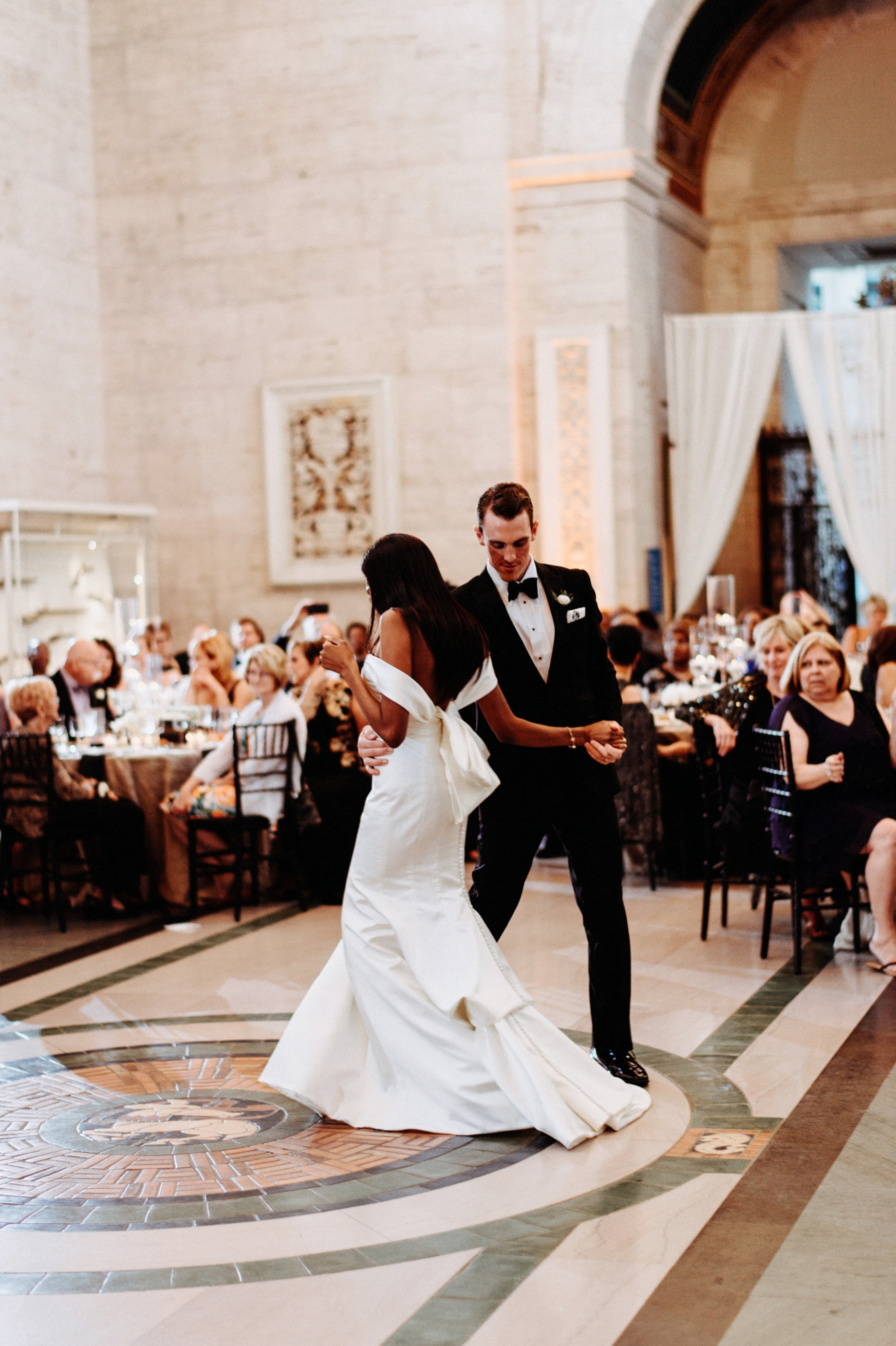 bride and groom dancing in the great hall at the DIA