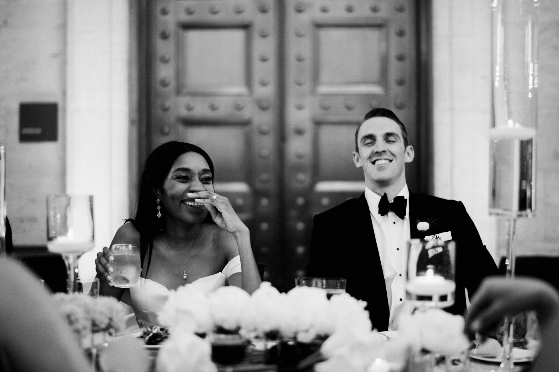 bride and groom reacting to speeches