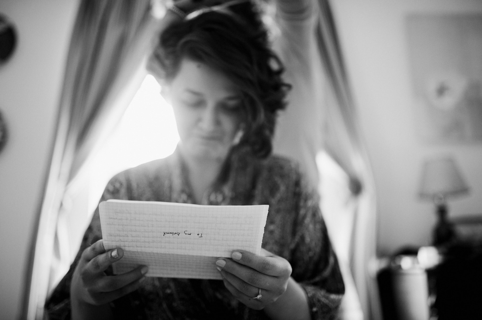 bride reading note from her groom