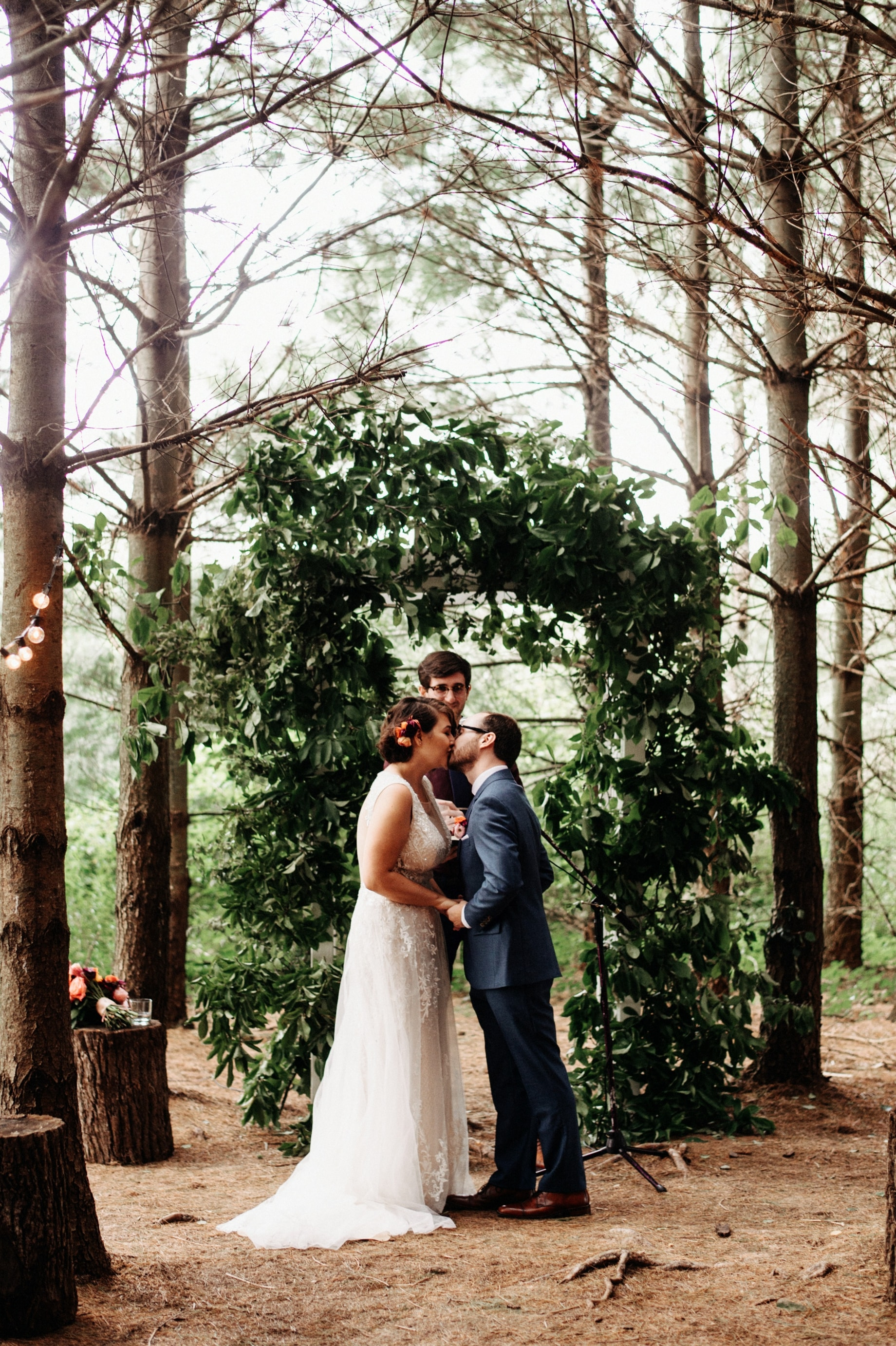 bride and groom share first kiss
