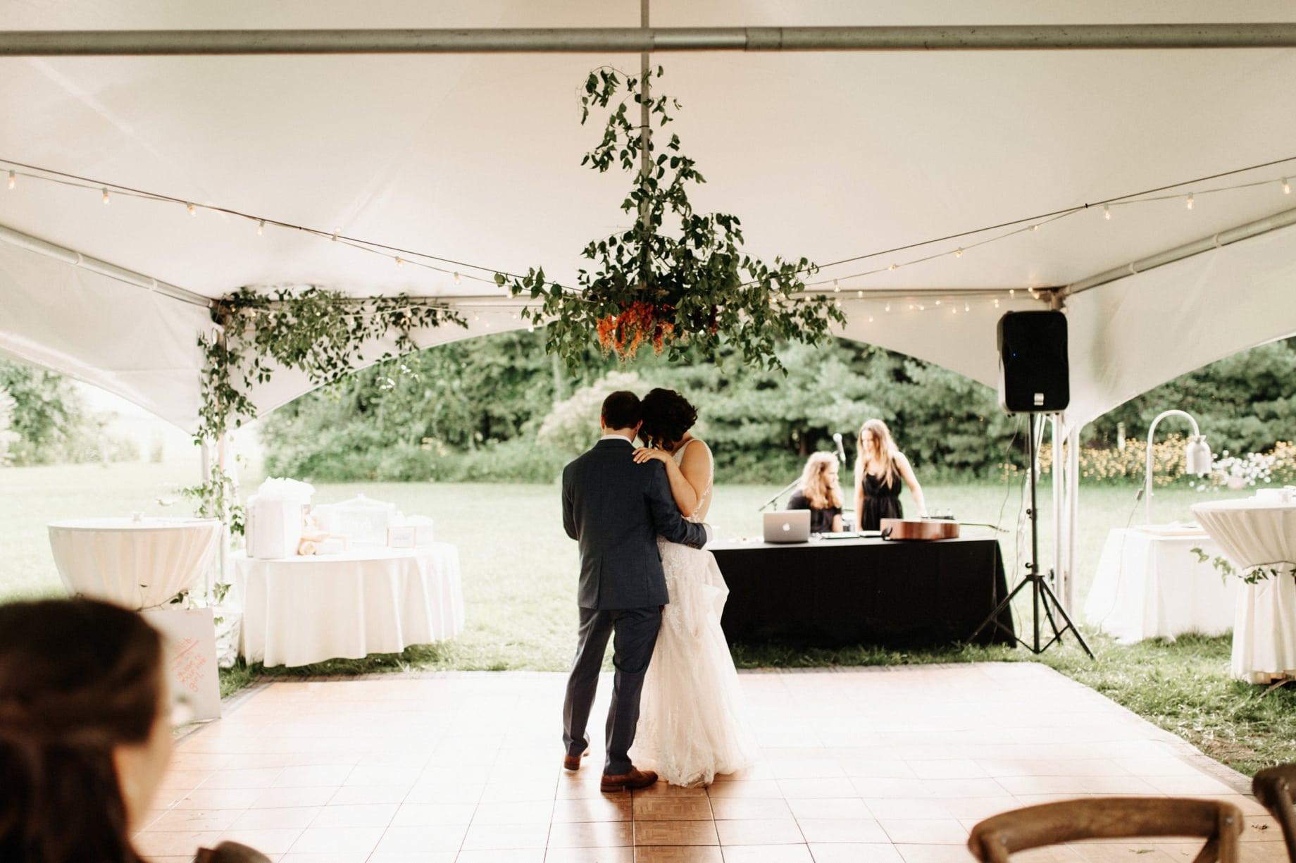 first dance under floral chandelier