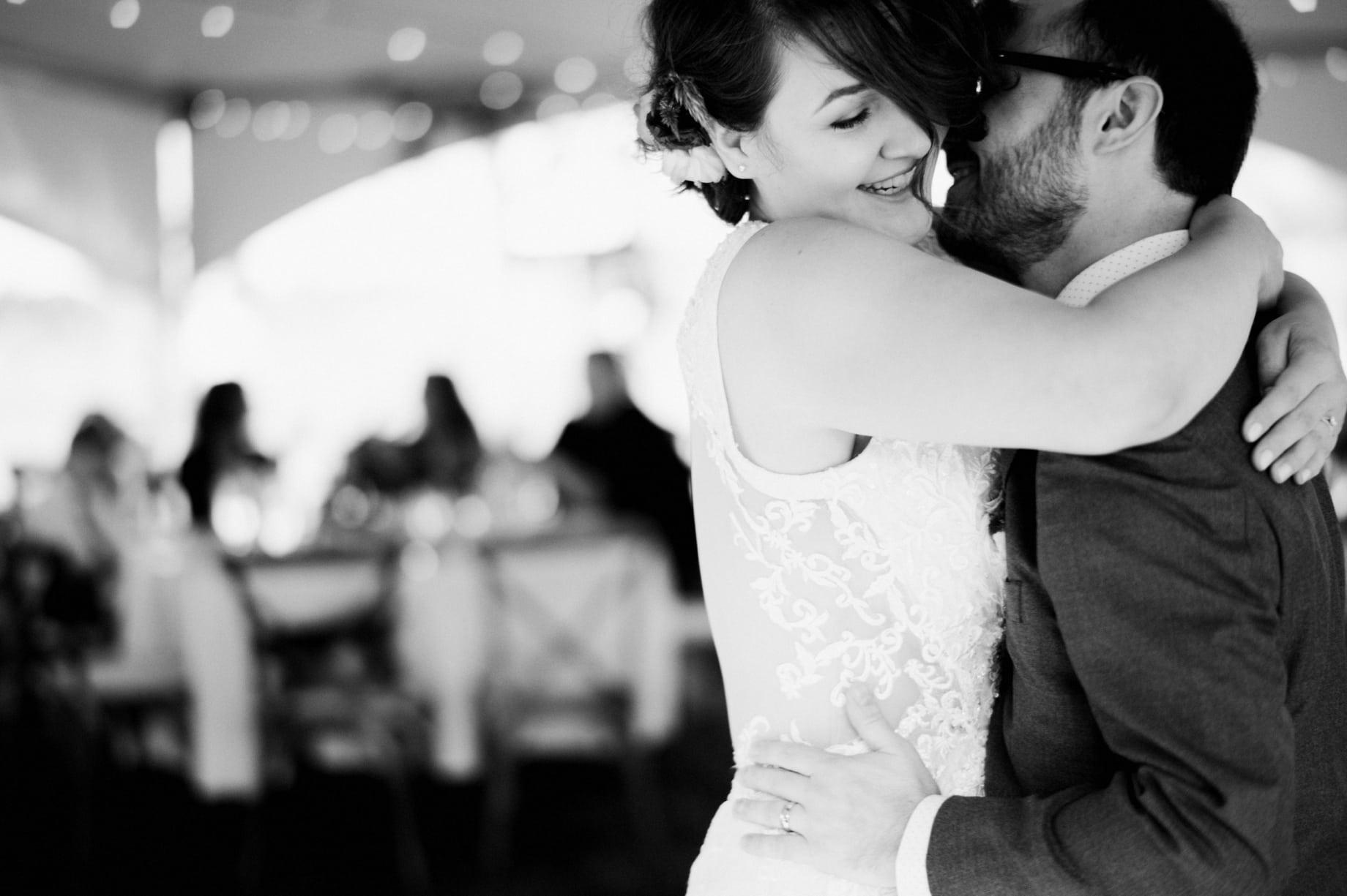 groom stealing a kiss