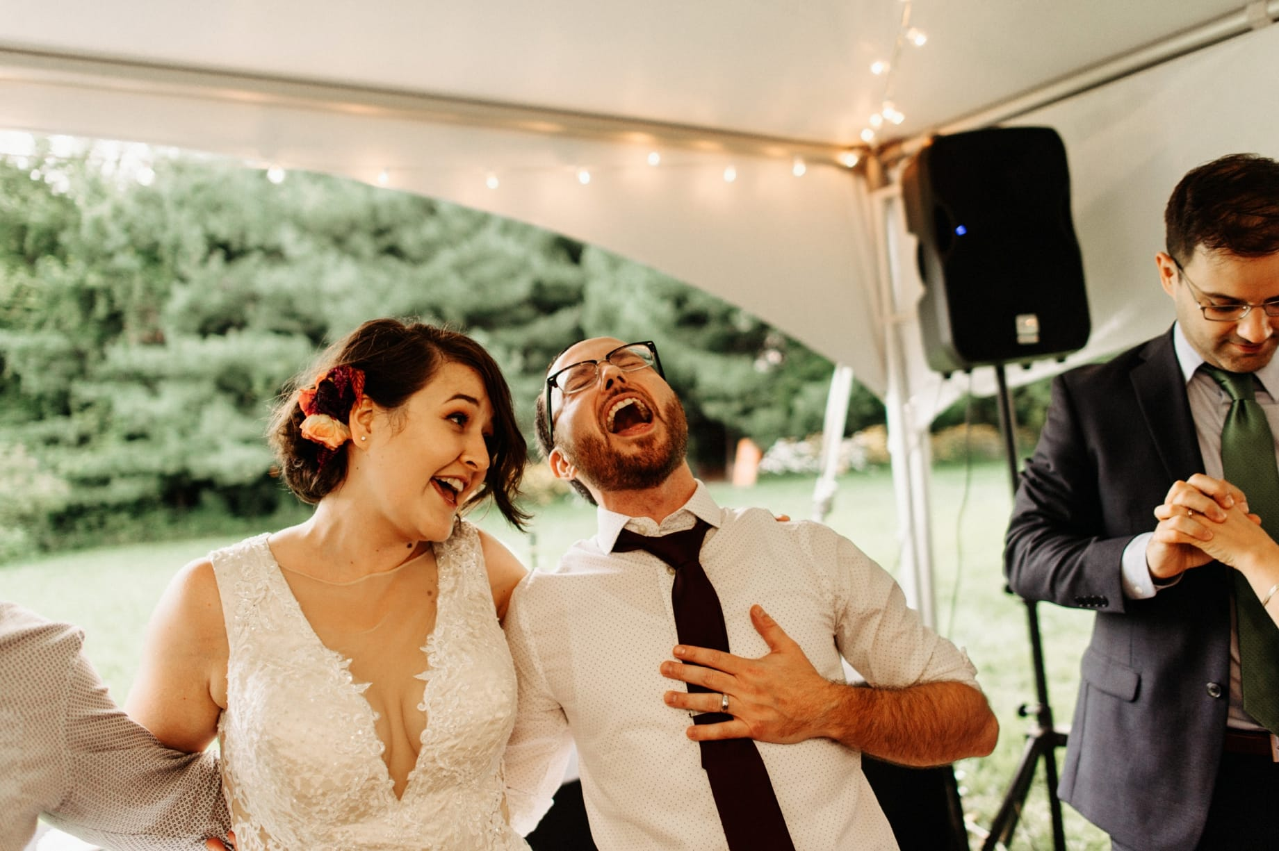 bride and groom singing along to songs