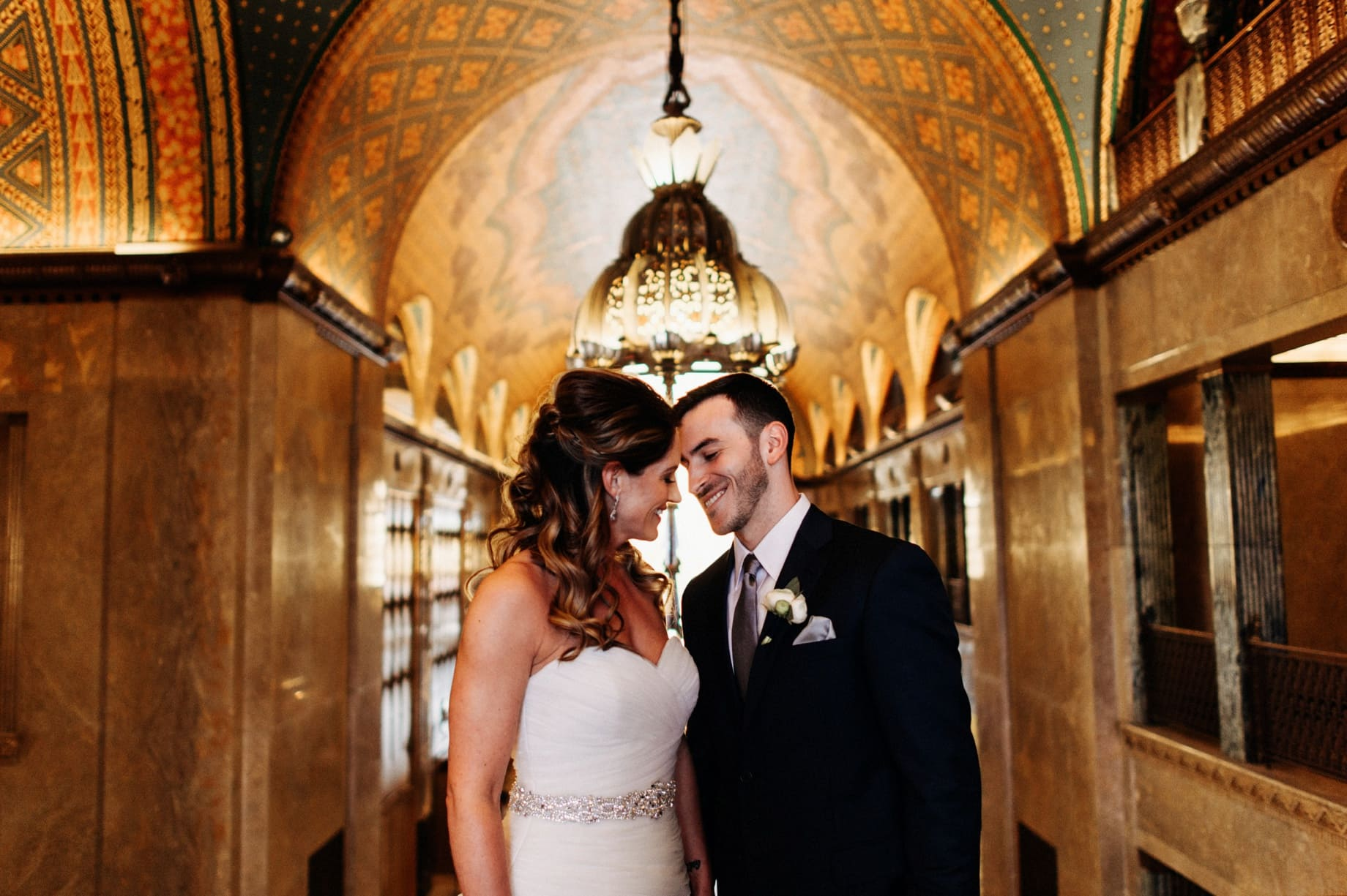 photography of a bride and groom inside the fisher building in detroit michigan