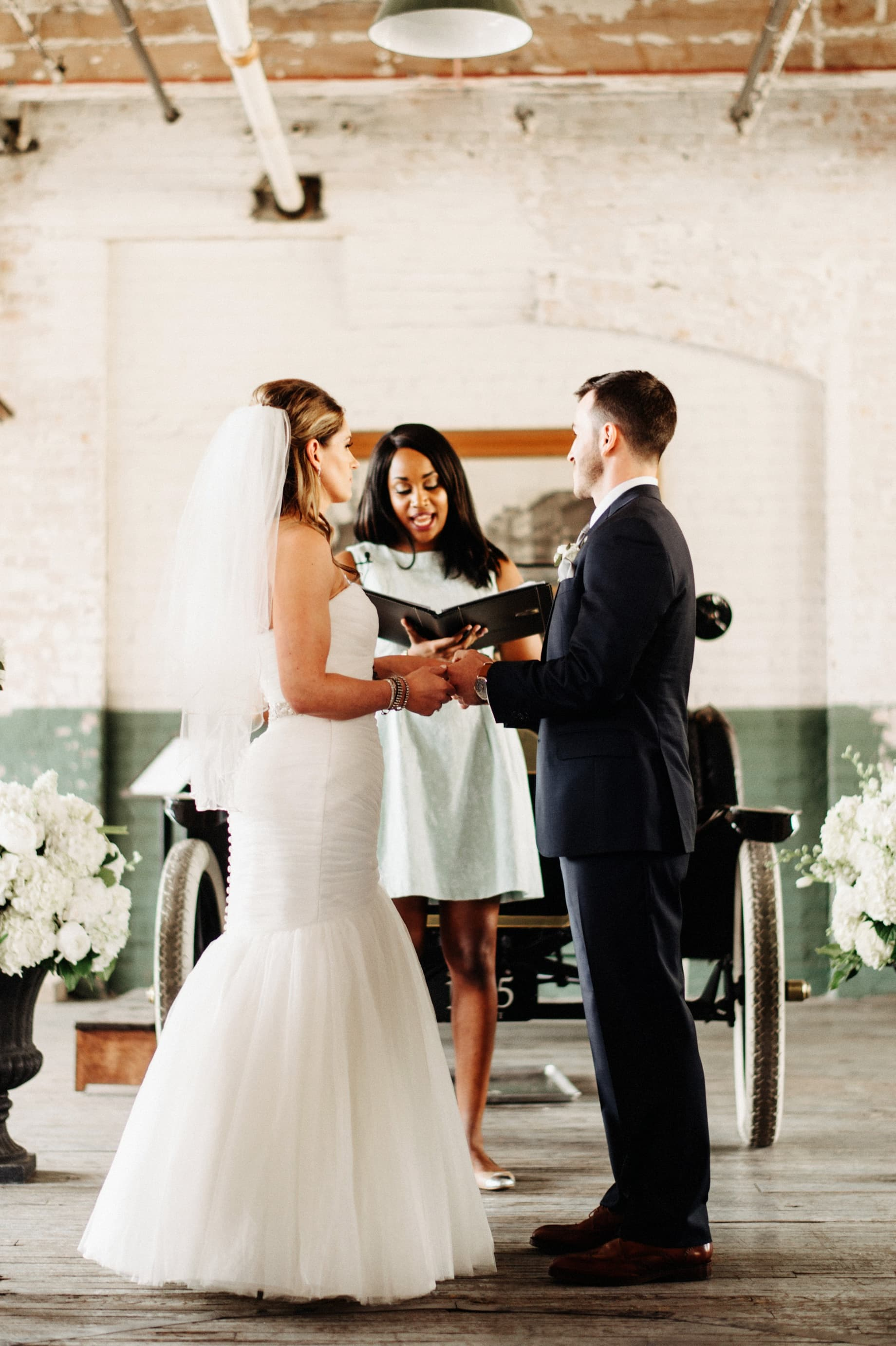 bride and groom during wedding ceremony at ford piquette plant