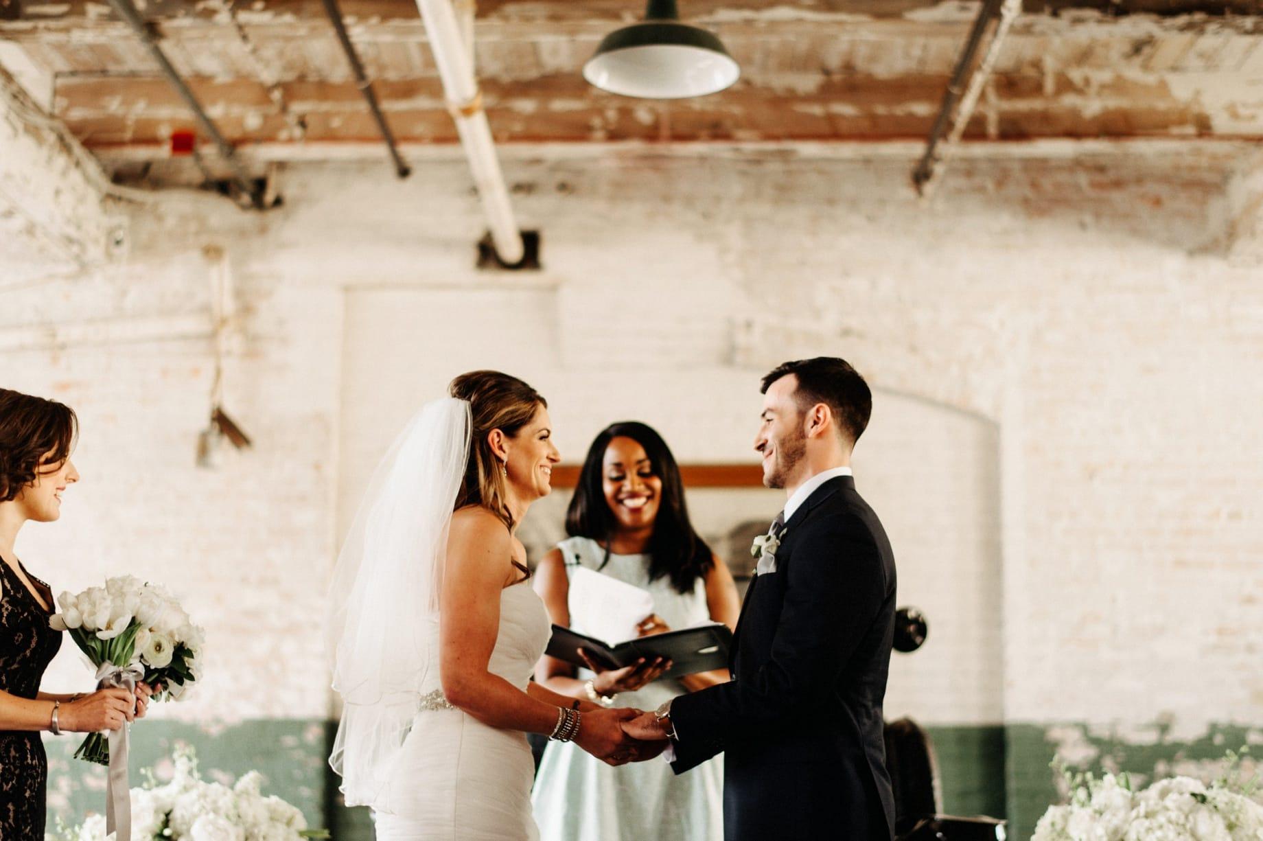 wedding ceremony at ford piquette plant by Detroit Wedding photographer Heather Jowett