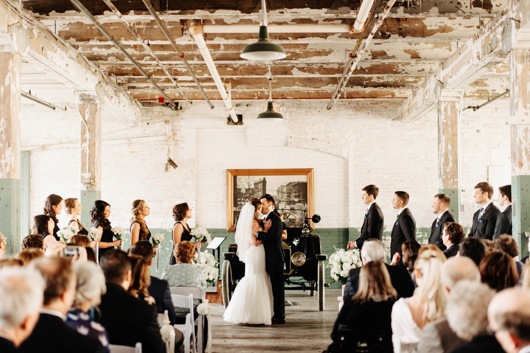 bride and groom share first kiss during their detroit wedding