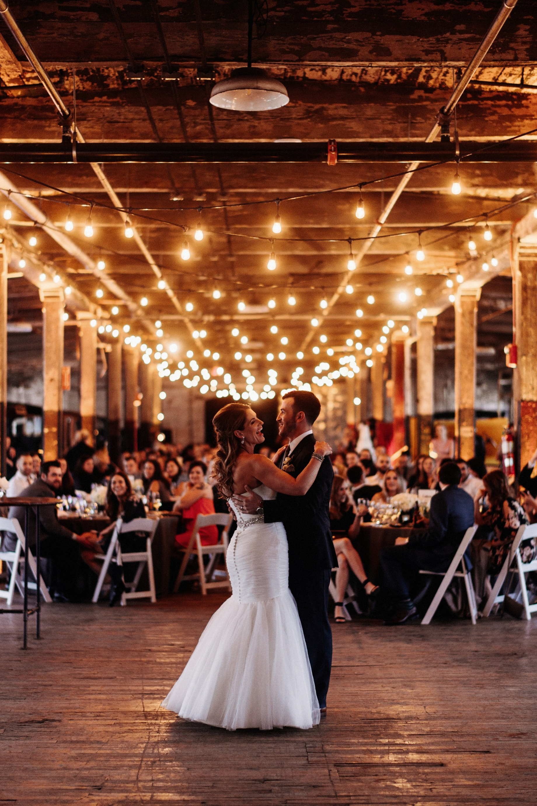 bride and groom share first dance at the ford piquette plant by Detroit Wedding photographer Heather Jowett