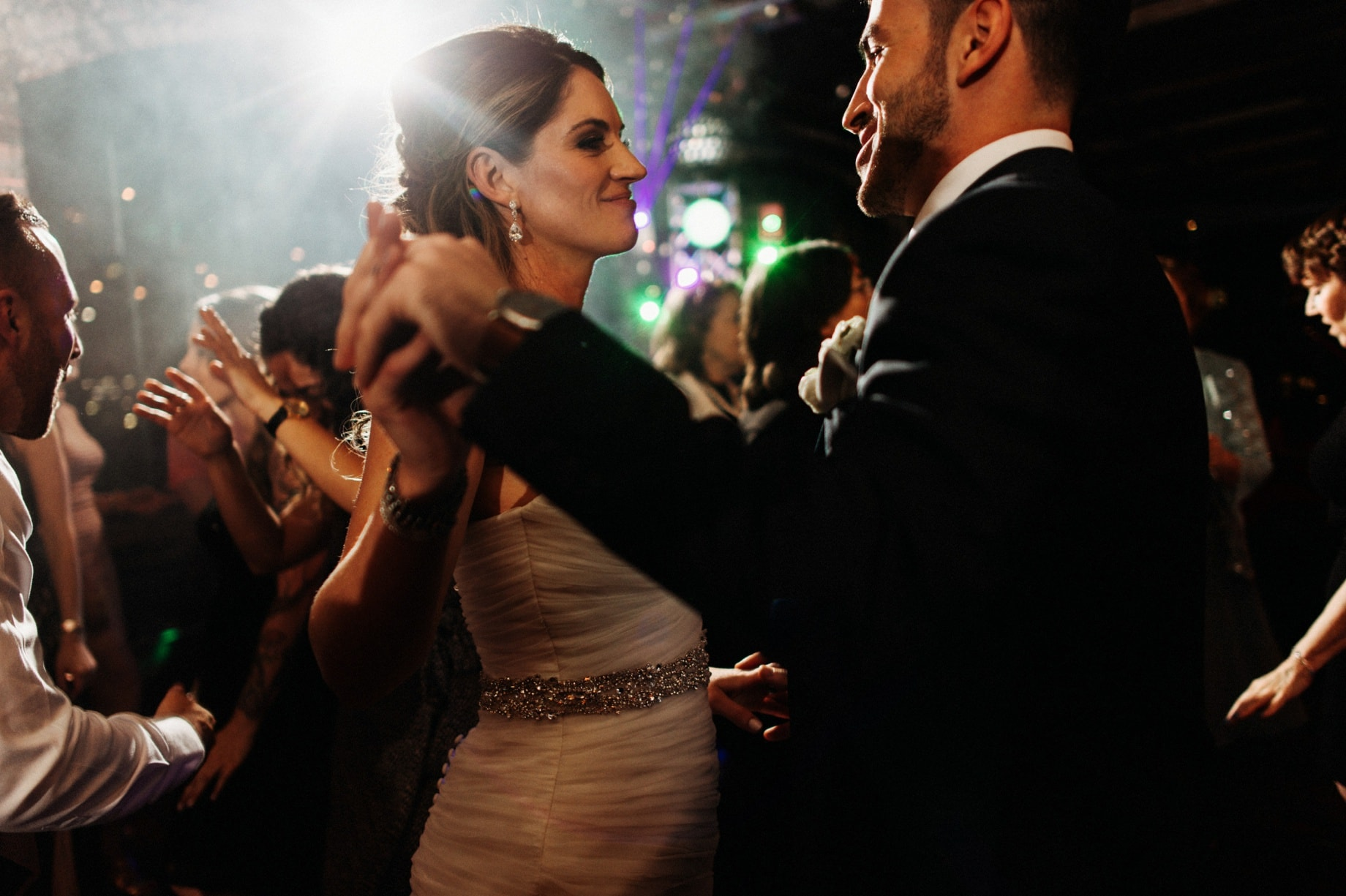 bride and groom dancing at their wedding in the Ford Piquette Plant by Detroit Wedding photographer Heather Jowett