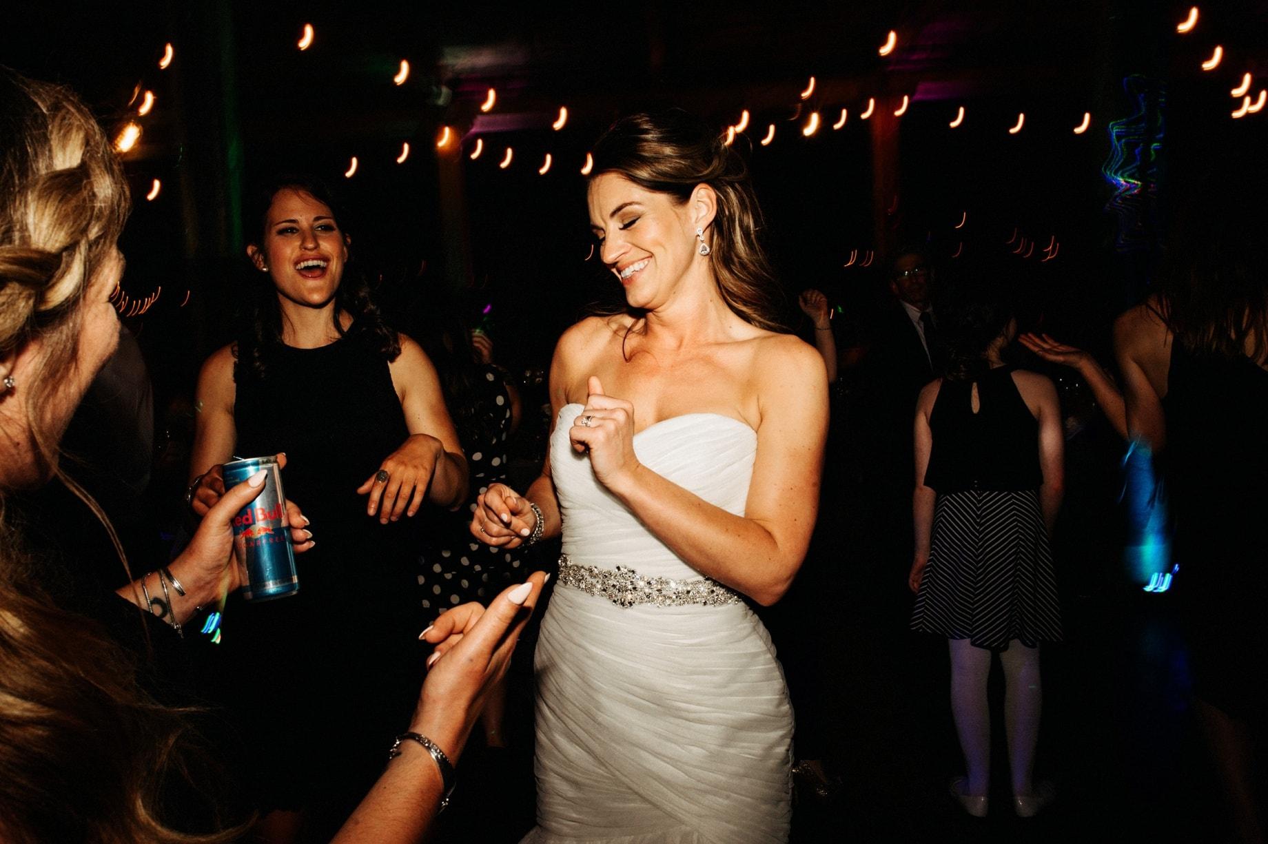 bride dancing with friends by Detroit Wedding photographer Heather Jowett