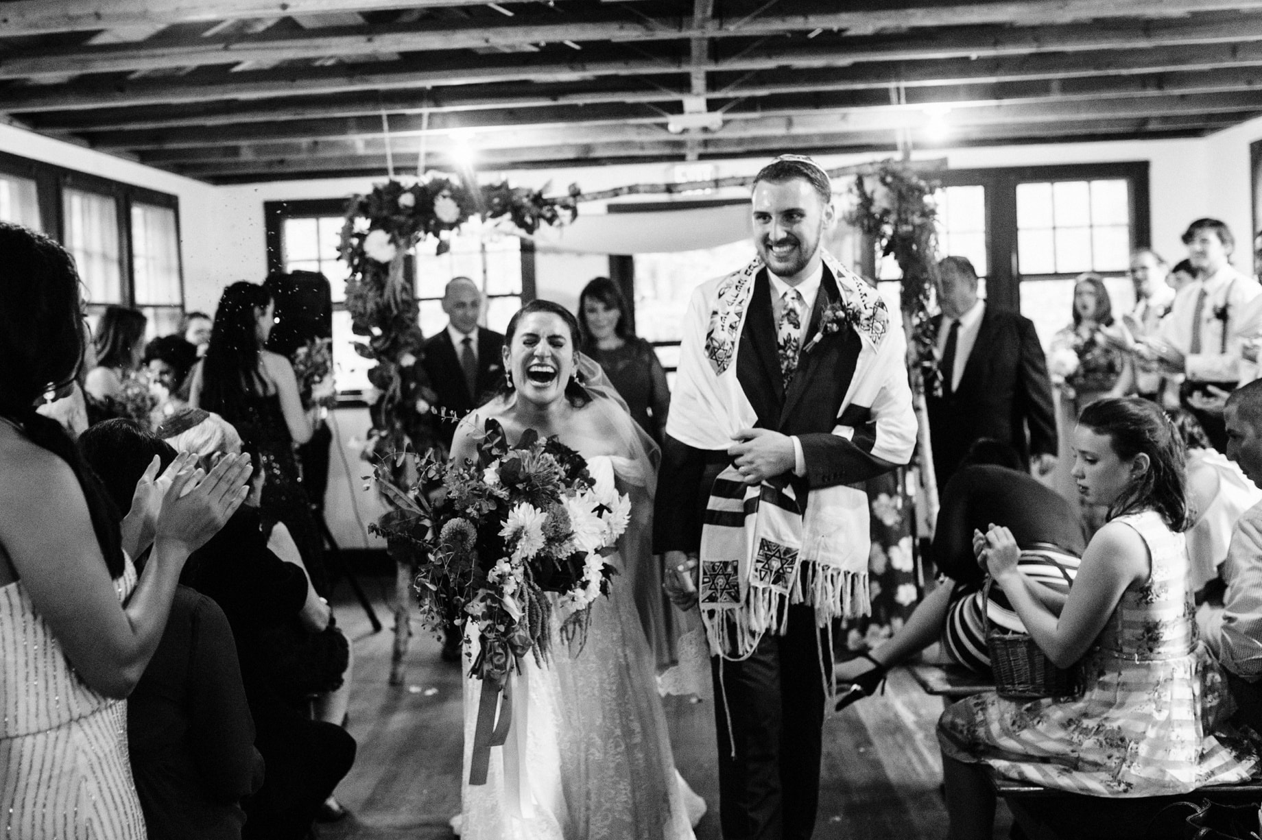 bride laughs as they leave their wedding ceremony