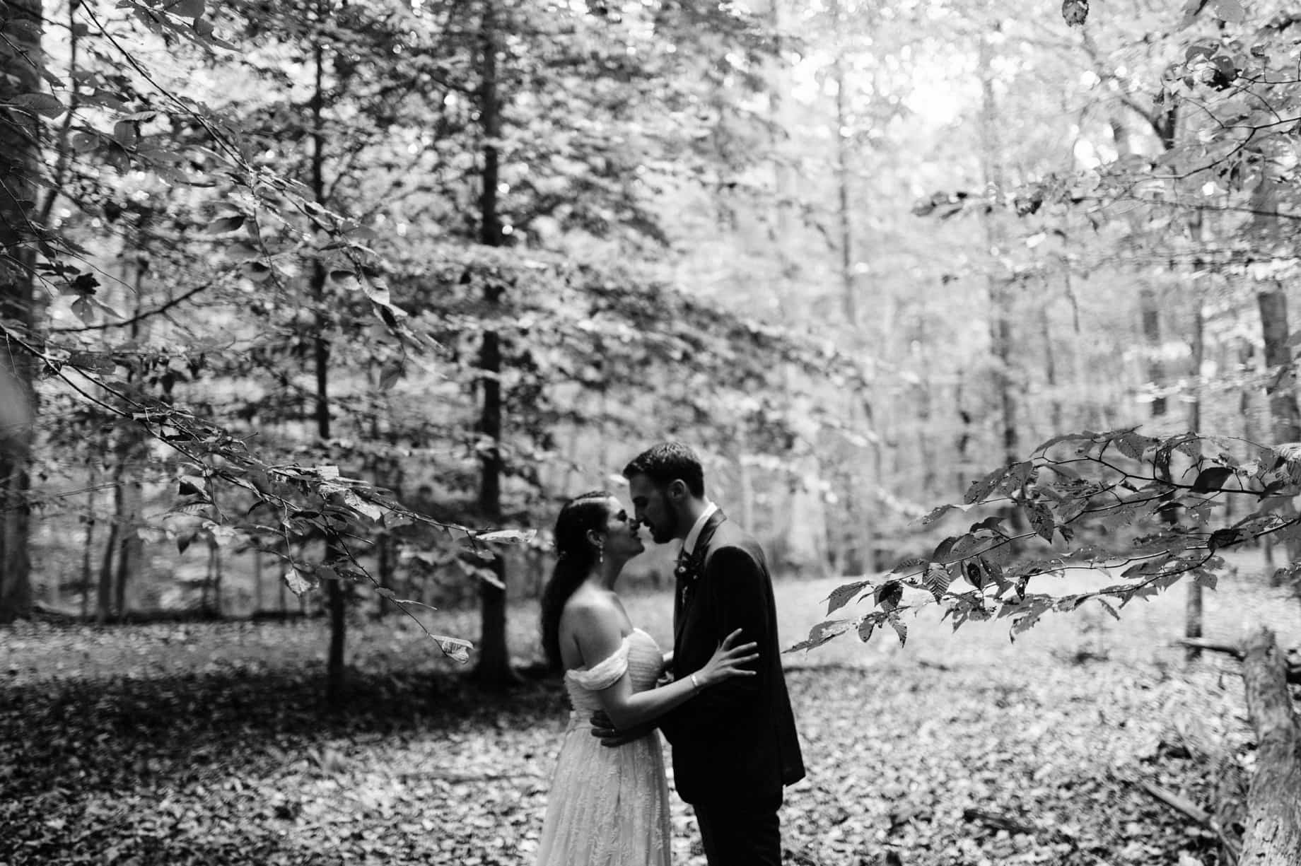 bride and groom pose for portraits in the woods at Prince William Forest Park