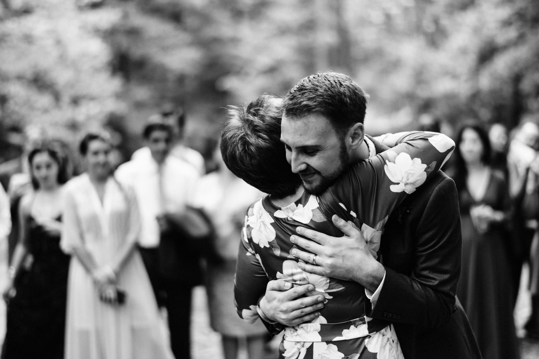 groom hugging his mother