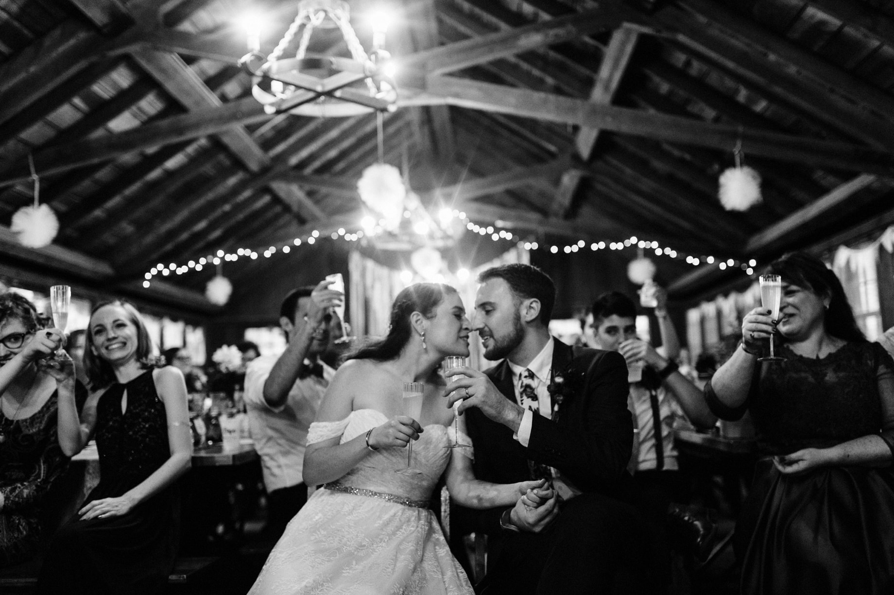 bride and groom raise their glasses