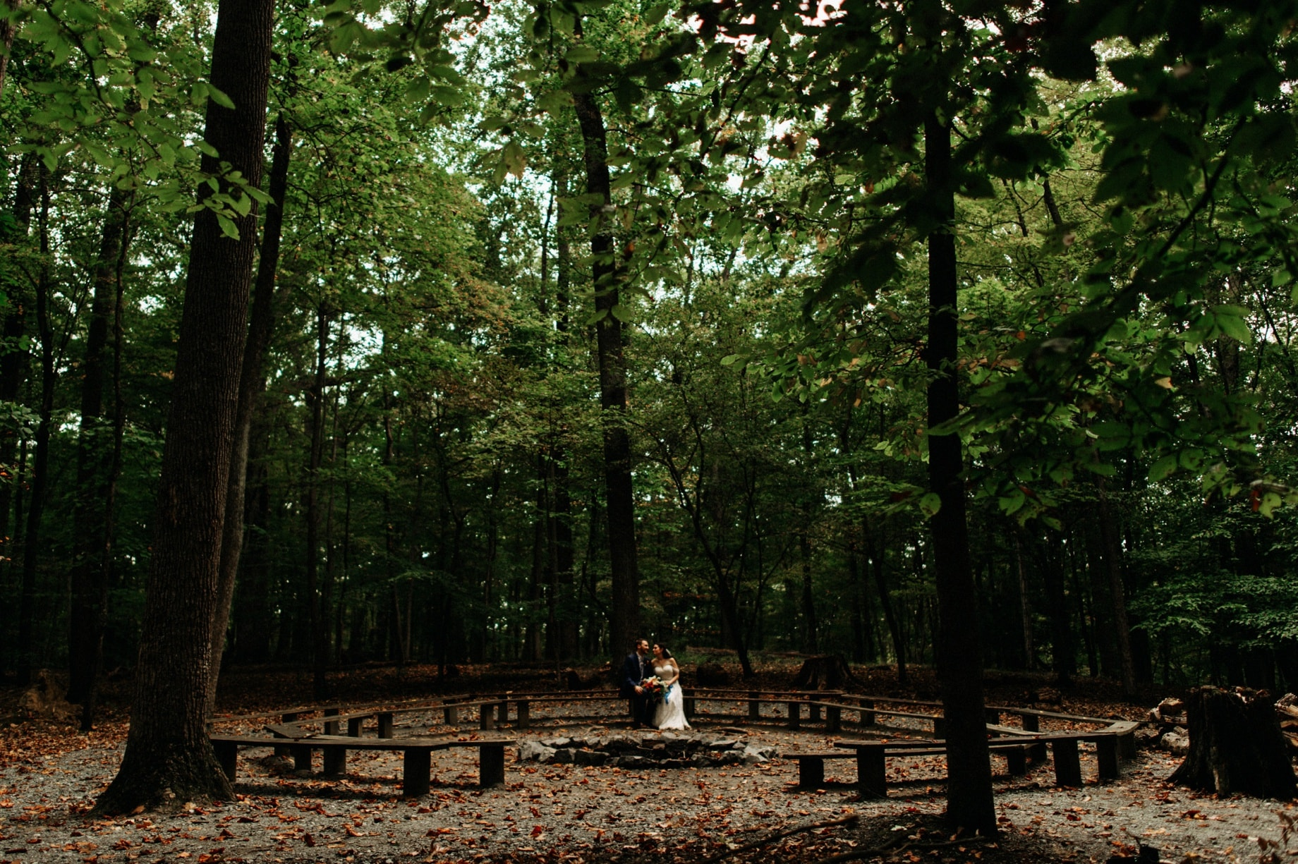 bride and groom at the fire circle at prince william forest park