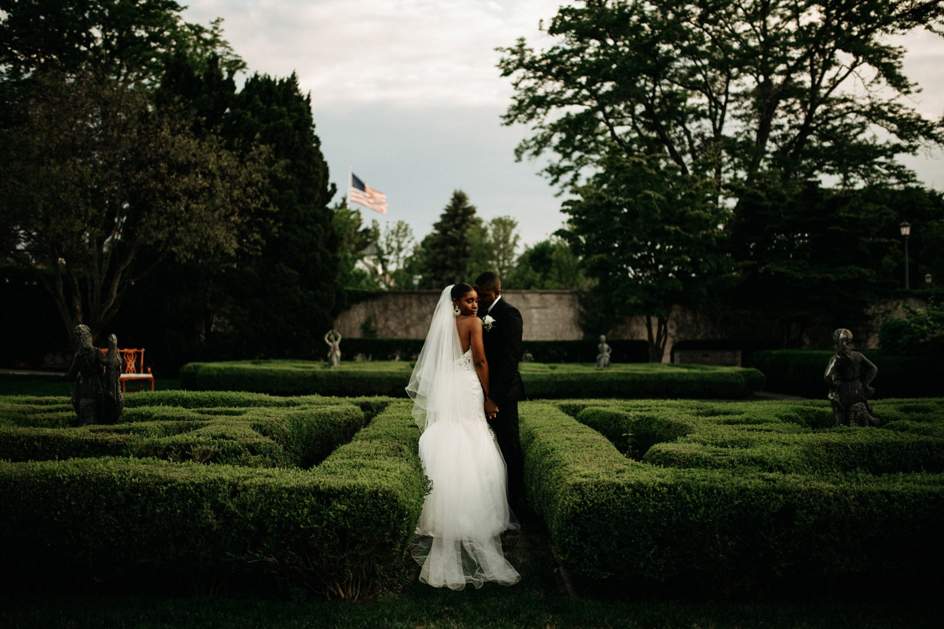portraits of bride and groom in the garden of the grosse point war memorial