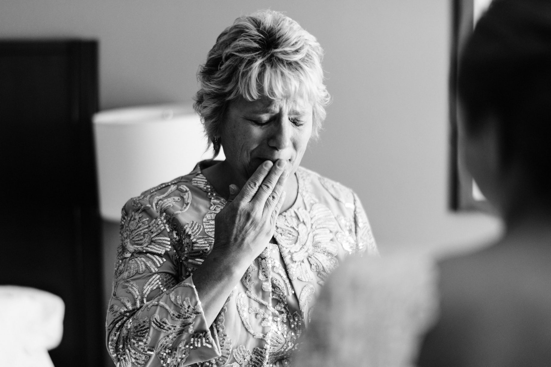 mother of the bride holds back tears seeing her daughter in her dress