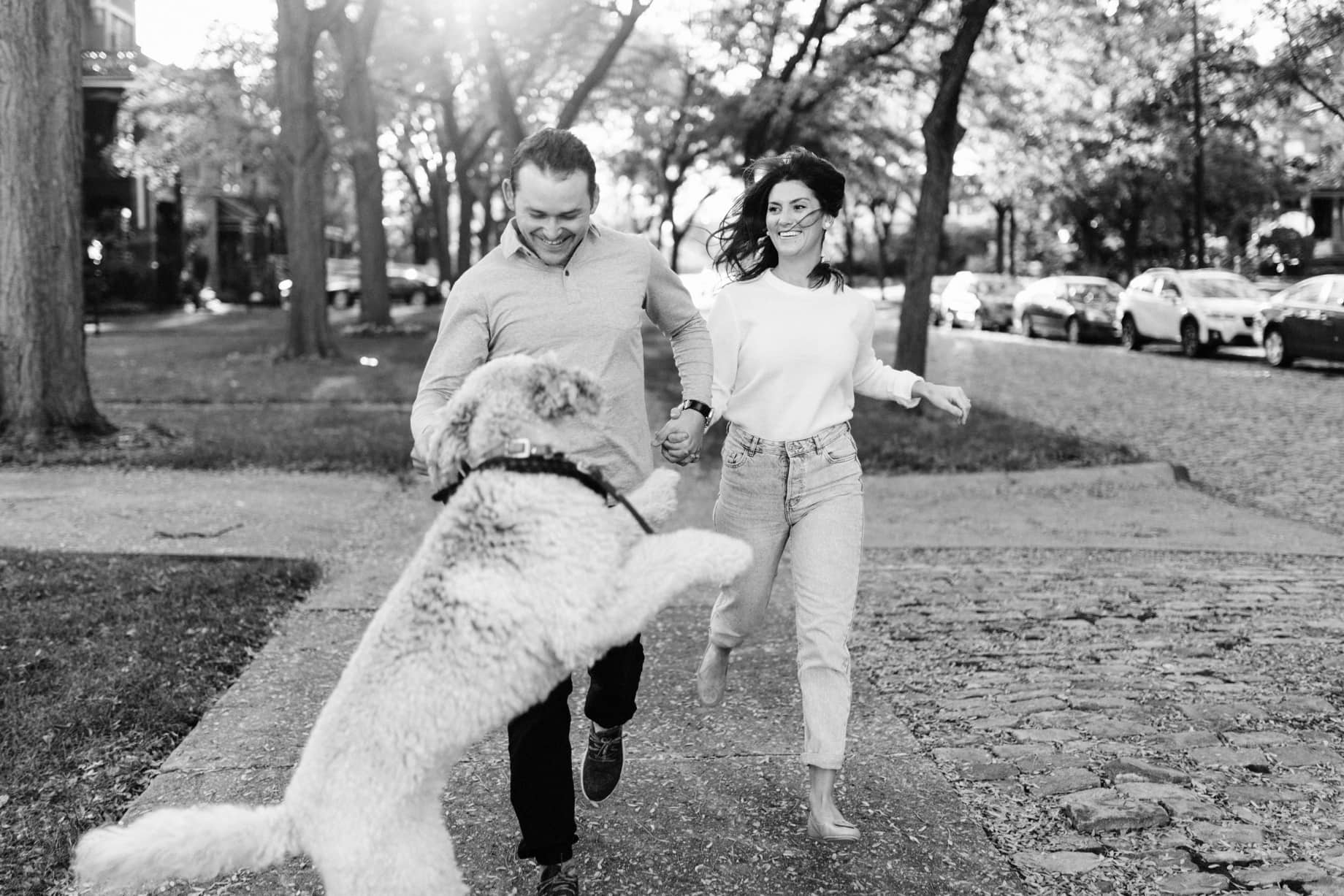 couple with their dog by detroit engagement session photographer Heather Jowett