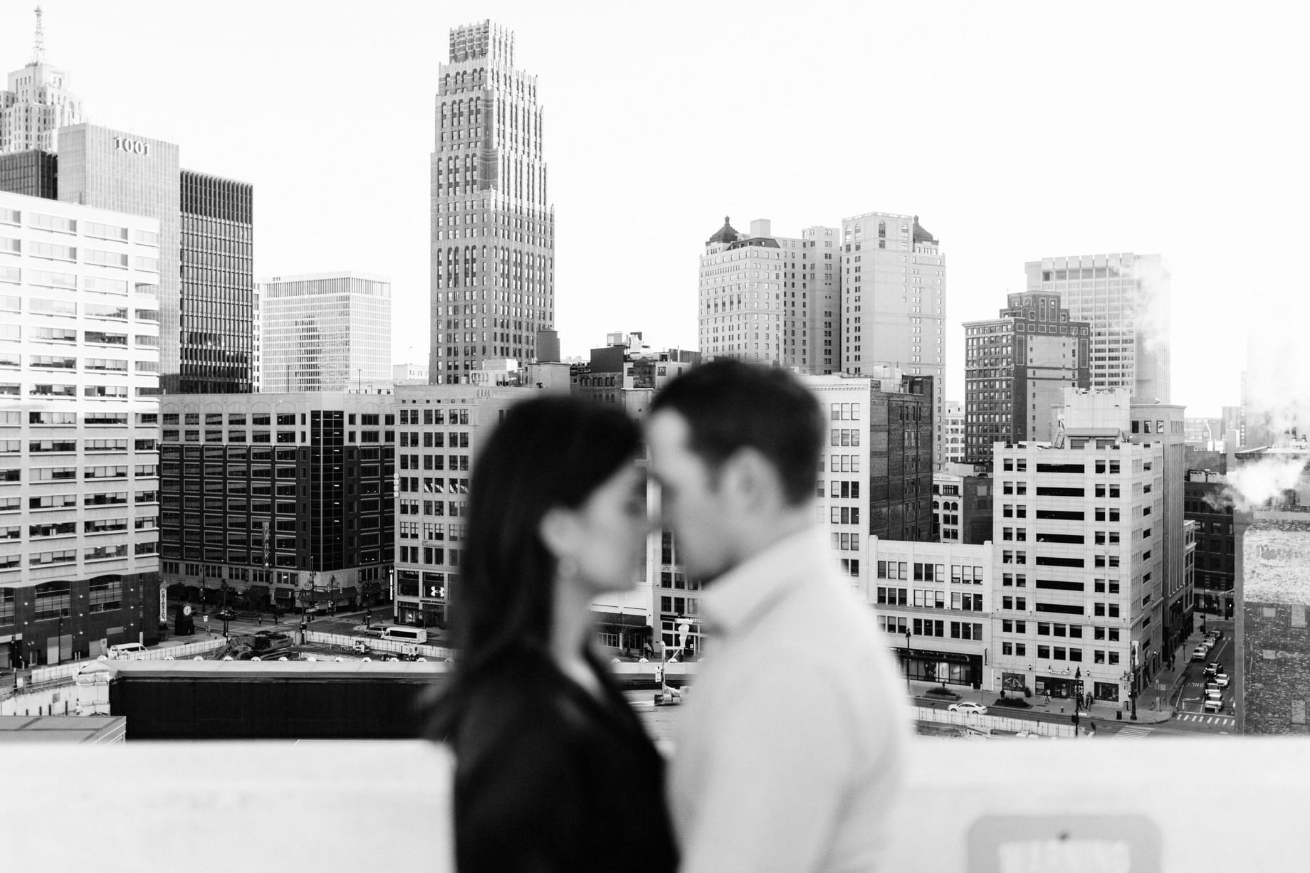 couple with the detroit skyline behind them