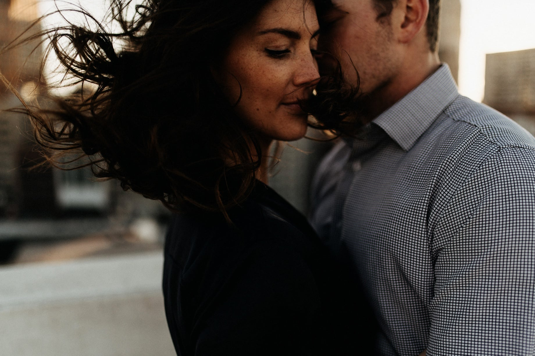 wind blowing in hair at a detroit engagement session