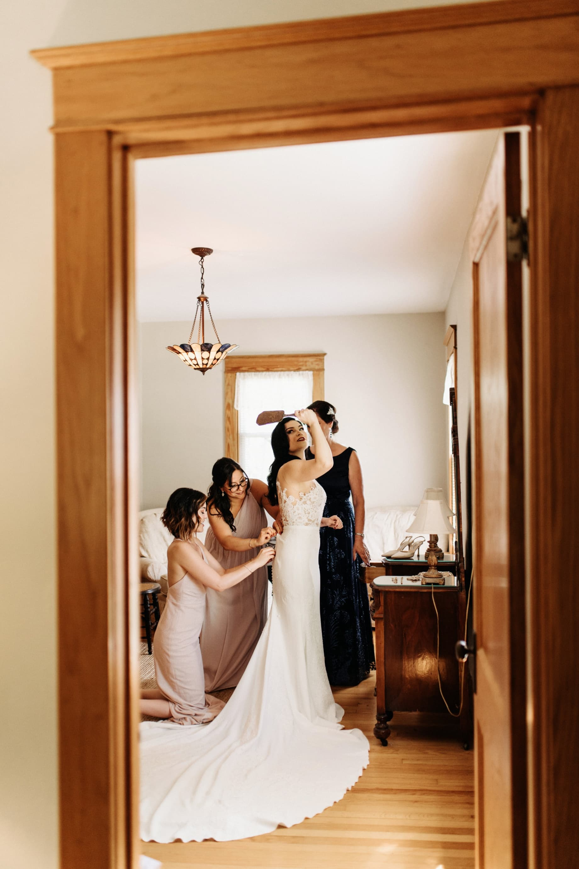 Bride getting into wedding dress at the wellers hospitality house