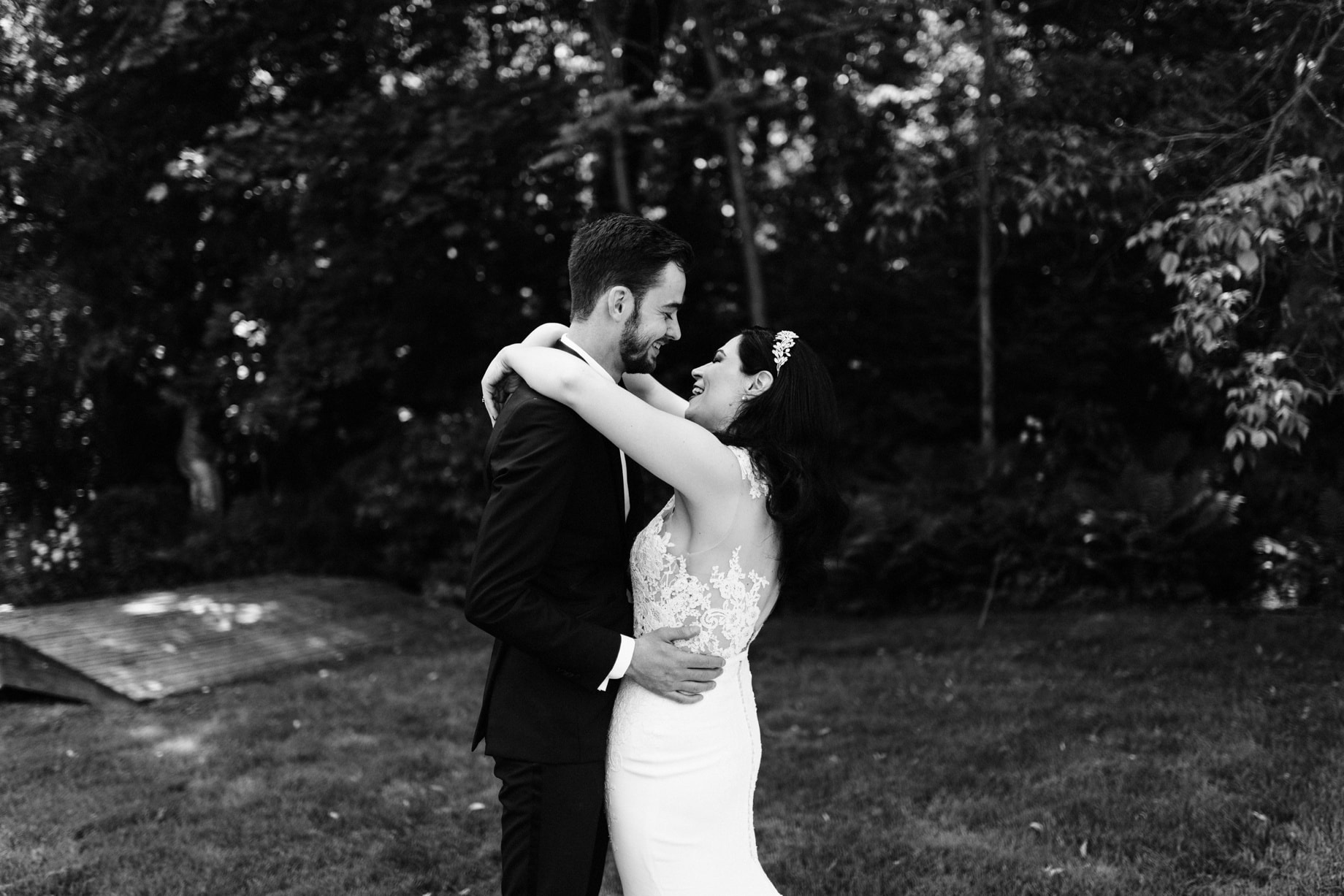bride and groom sharing a laugh after first look