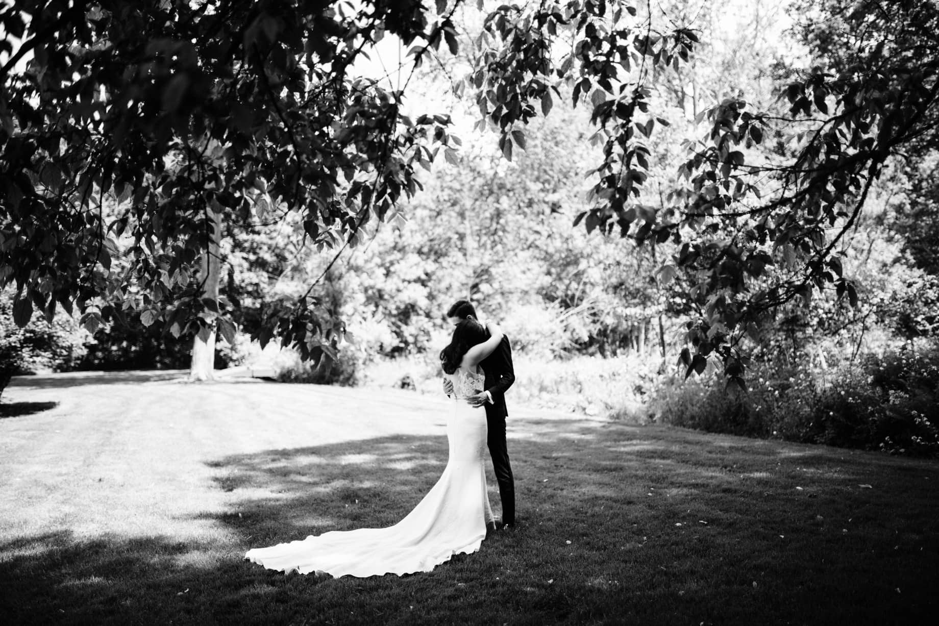 black and white portrait of a bride and groom embracing